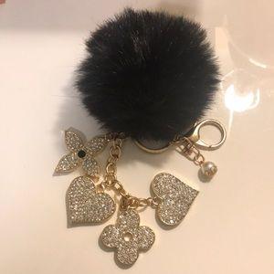 Louis Vuitton keychain w/ Furry Pom, never worn